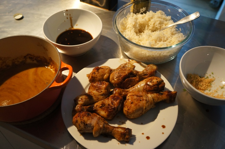 Marinade, chicken, dipping sauce, and rice ready for serving